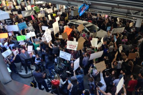 Spontaneous protests at LAX as ban on travelers from seven Muslim countries leads to detentions of travelers