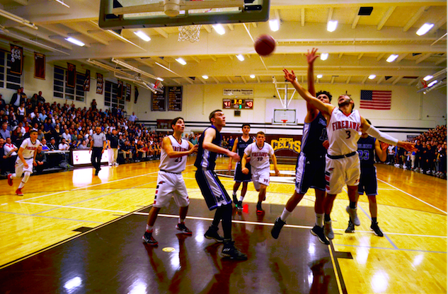 AIRBORNE%3A+No.+3+Eitan+Halpert+overcomes+a+Wildcat+block+to+score+two+points+late+in+the+third+quarter+in+the+gym+of+Crespi+Carmelite+High+School+in+Encino+March+1.++