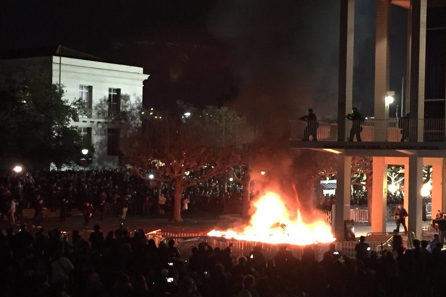 PROTEST%3A+Joined+by+150+outsiders%2C+Berkeley+students+protested+Milo+Yiannoupoulous+by+setting+fires+and+destroying+property+Feb.+1..