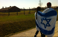 AUSCHWITZ 2013: Like thousands before them, members of this year's senior class wore Israeli flags while walking through the infamous death camp.