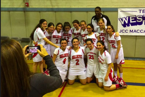 "SMILES: It was a moment to savor for the Firehawk girls basketball team March 1 after defeating Glendale Adventist to win the Division title. Coach Ronnie ""Flava"" Winbush, at top, joined the post-game celebration."