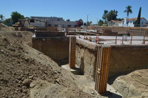 GROUND: Pillars rise toward street level at the site of the new building.