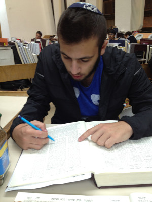 INDOORS: Alumnus Mati Hurwitz '15 studying at Yeshivat Har Etzion, whose students now must ask for permission to visit other parts of the country.