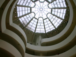 A spider's web design divides the light streaming in from the roof of the circular seven-story Guggenheim Museum in New York.