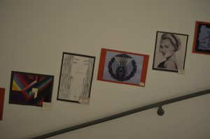 Along the school's staircase are art pieces created by students in Mrs. Roen Salem's AP and 10th grade art classes.