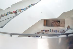 Similar to the Guggenheim's staircase, Shalhevet's staircase features white walls and circular stairways that overlook a foyer below.