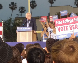 Photo of Bernie speaking at 8:04 p.m.. Photo by Daniel Lorell