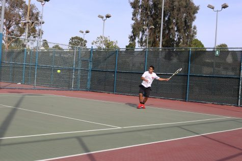 WINNERS: Sophomore Arman Marghzar is one of 13 players on the Firehawk tennis team.