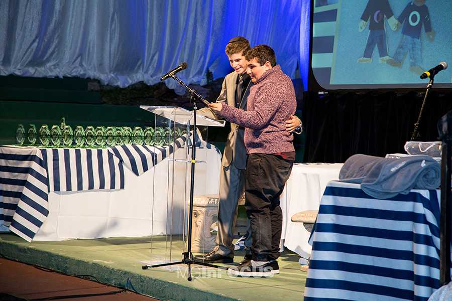 IMPROVISED: In the middle of his acceptance speech, Yaakov had his friend, nicknamed Sam (right), join him on stage. Yaakov and Sam, who has autism, have been friends for many years.