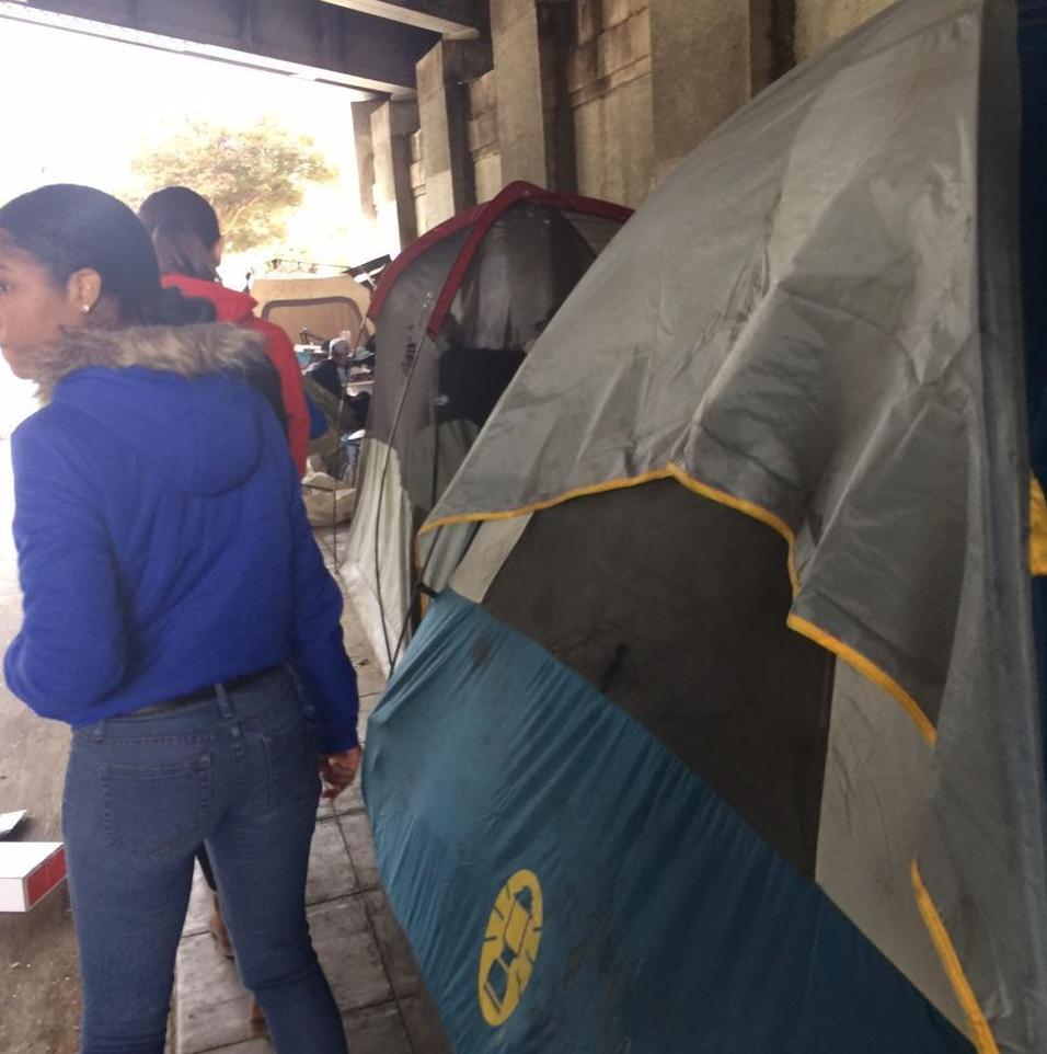 UNDERNEATH: Juniors Rosie Wolkind and Maia Zelkha visited a homeless encampment beneath a Downtown freeway to distribute cameras. They have received four in return so far.